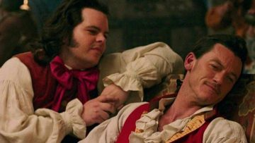 Gaston and Lefou hugged up in a bar. Disney is gay.